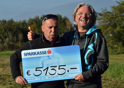 Team mate Werner Luidolt received this monster check for winning the ION-2-Hundred-Challenge. If you think Wolfi is suffering giving him the check, you are wrong. He thinks it's worth it.